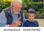 teacher with learning children... | Shutterstock . vector #1034256982