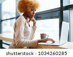 beautiful woman working on... | Shutterstock . vector #1034260285