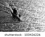 Silhouette Of A Man Kayaking I...
