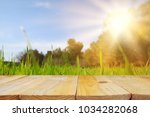 empty rustic table in front of... | Shutterstock . vector #1034282068