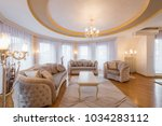 interior of a luxury living... | Shutterstock . vector #1034283112
