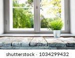 desk of free space with window... | Shutterstock . vector #1034299432