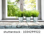 desk of free space with window... | Shutterstock . vector #1034299522