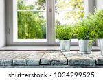desk of free space with window... | Shutterstock . vector #1034299525