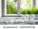 desk of free space with window... | Shutterstock . vector #1034299528