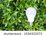 led bulb in the green nature... | Shutterstock . vector #1034323372