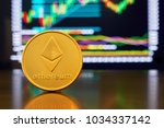 gold coin ethereum stacked on a ... | Shutterstock . vector #1034337142