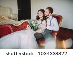 the bride and groom in hotel... | Shutterstock . vector #1034338822
