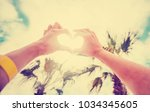 hands in heart shape framing... | Shutterstock . vector #1034345605