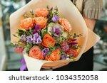 female florist holding... | Shutterstock . vector #1034352058
