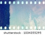 blue film strip frame with wet... | Shutterstock . vector #1034355295