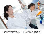 female scientist researching in ... | Shutterstock . vector #1034361556