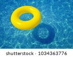 colorful inflatable tube... | Shutterstock . vector #1034363776