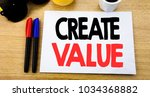 Small photo of Handwritten text caption showing Create Value. Business concept writing for Creating Motivation written on sticky note with copy space old wood wooden background with sunglasses