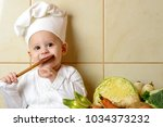 adorable baby boy in kitchen | Shutterstock . vector #1034373232