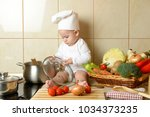 adorable baby boy in kitchen | Shutterstock . vector #1034373235