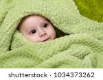 baby boy under the green towel | Shutterstock . vector #1034373262