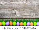 wooden background with easter... | Shutterstock . vector #1034375446