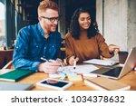 positive caucasian young man... | Shutterstock . vector #1034378632