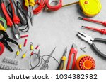 different electrical tools on... | Shutterstock . vector #1034382982