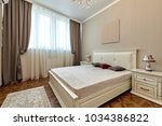 bedroom with a beautiful... | Shutterstock . vector #1034386822