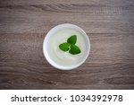 ceramic bowl of white yogurt... | Shutterstock . vector #1034392978