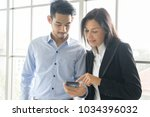 business man and woman wearing... | Shutterstock . vector #1034396032