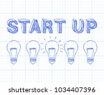 hand drawn start up sign and... | Shutterstock .eps vector #1034407396