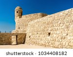 watch tower at bahrain fort. a... | Shutterstock . vector #1034408182