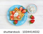 fresh strawberries with crispy...   Shutterstock . vector #1034414032