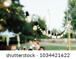light bulb decor in outdoor... | Shutterstock . vector #1034421622