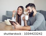 young couple relaxing at home... | Shutterstock . vector #1034423242