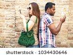 bored multiracial couple using... | Shutterstock . vector #1034430646