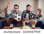 watching the big game sport... | Shutterstock . vector #1034437945