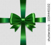 green ribbon bow isolated... | Shutterstock .eps vector #1034440102