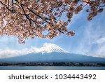 mount fuji at lake kawaguchiko... | Shutterstock . vector #1034443492