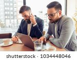 two handsome businessmen... | Shutterstock . vector #1034448046