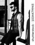 handsome young model standing...   Shutterstock . vector #1034479945