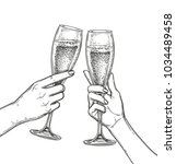 two hands clinking glasses of... | Shutterstock .eps vector #1034489458
