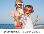 two happy little children in... | Shutterstock . vector #1034493478