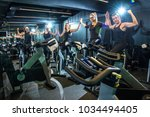 group of fitness girls holding... | Shutterstock . vector #1034494405