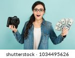 young surprised woman with... | Shutterstock . vector #1034495626