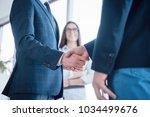 two confident businessman... | Shutterstock . vector #1034499676