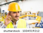 factory worker making can't... | Shutterstock . vector #1034519212