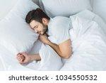 top view of bearded man... | Shutterstock . vector #1034550532