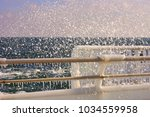 metallic fence in the ice with... | Shutterstock . vector #1034559958
