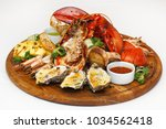 Tasty Seafood On Wooden Board...