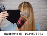 master shows palette of hair... | Shutterstock . vector #1034575792