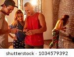 young modern dancers rest... | Shutterstock . vector #1034579392