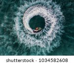 people are playing jet ski at... | Shutterstock . vector #1034582608